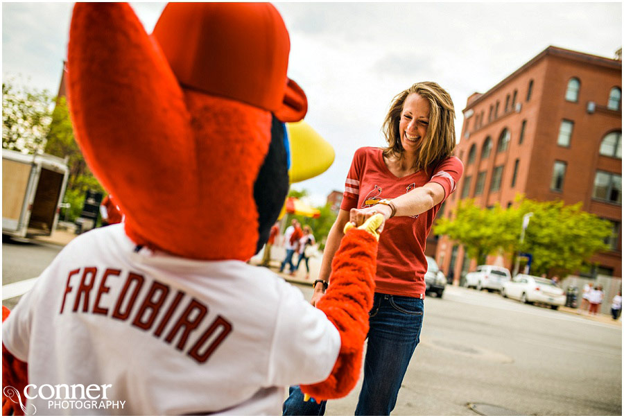 st louis cardinals ballpark village engagement photos with fredbird